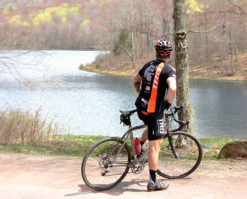 Cyclist pauses to take in the sights beside Cooper Lake